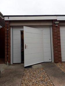 Sectional garage door with wicket