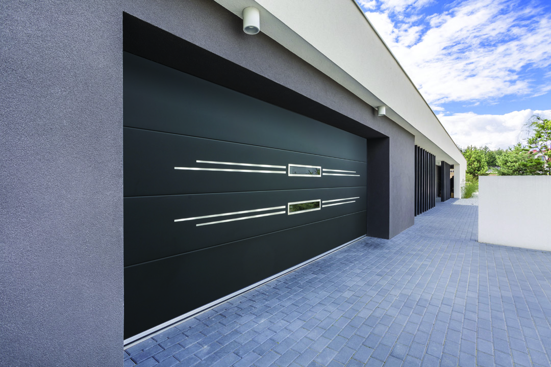 Sectional garage door with applique & elongated windows