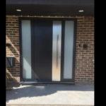 Front door with applique under the handle
