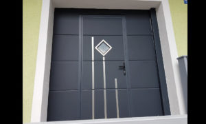 Sectional garage door with wicket & decor