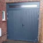 Side hinged door with transom