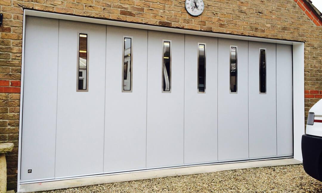 Sliding garage door with oblong windows