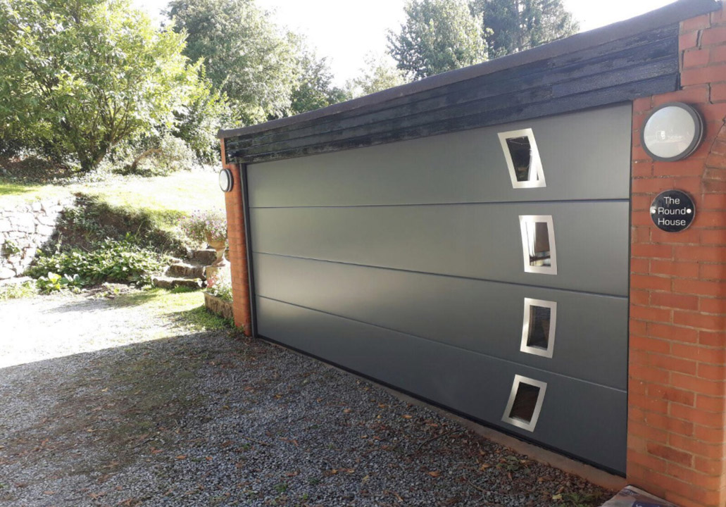 Sectional garage door with applique & half moon windows