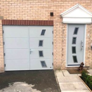 Side Hinged Garage Door - half-moon shape windows