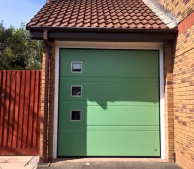 6' wide sectional door with aluminium frame