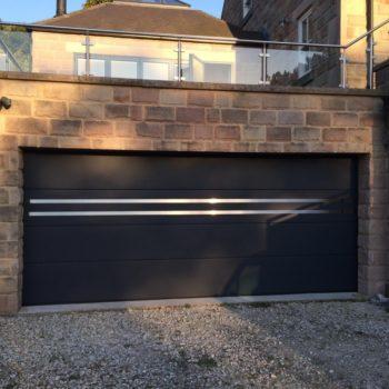 Sectinal door with custom stainless steel applique