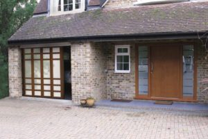 Sliding door with glazed custom panels