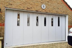 Sliding garage door with oblong windows