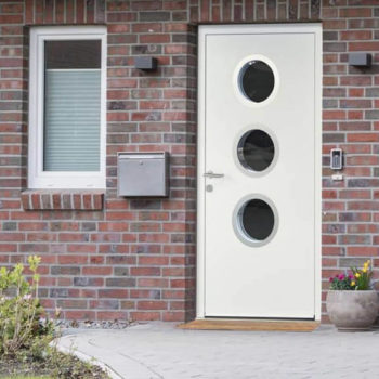 Aluminium front door with portholes