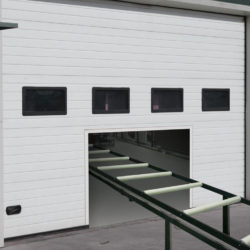 Sectional door over production line