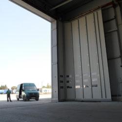 Bi-parting round the corner door 8x8 m