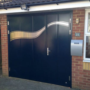 Side hinged door with custom stainless steel applique