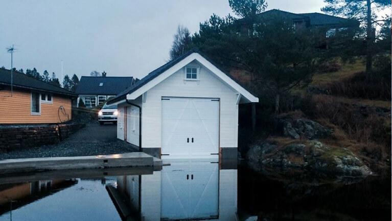 Boat garage on the lake shore