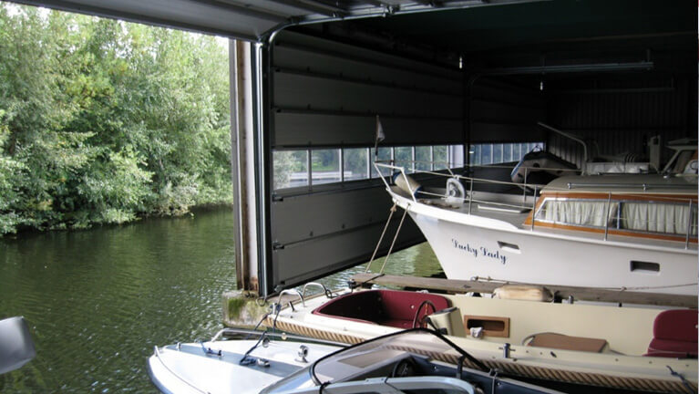 Sectional door for boat shelter