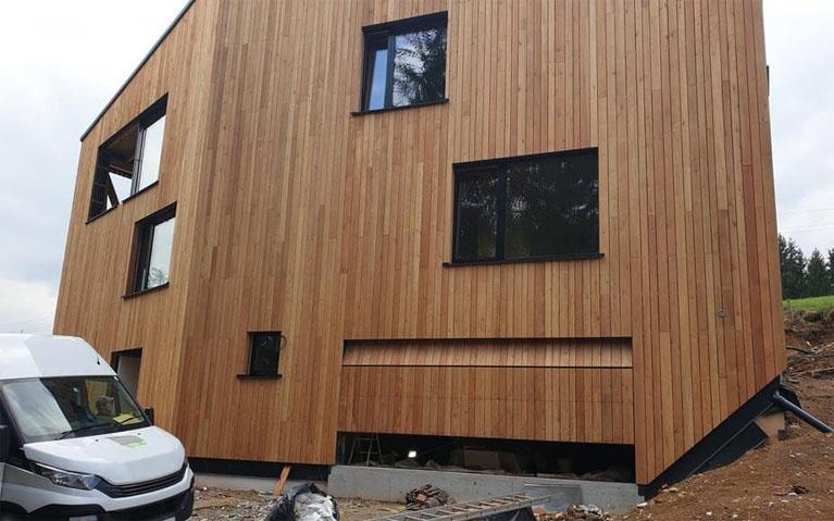Garage door clad same as façade