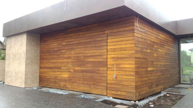 Garage door clad with oak planks