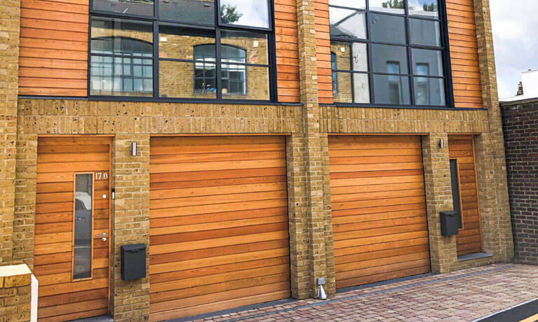 Garage door clad to match façade design
