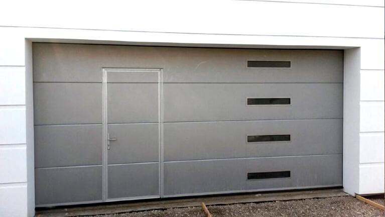 Sectional garage door with wicket & oblong windows