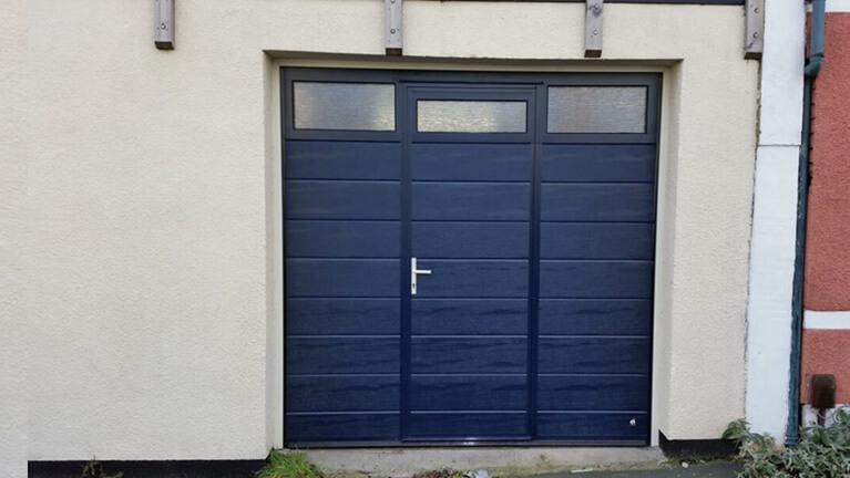 Sectional garage door with wicket & glazed panel