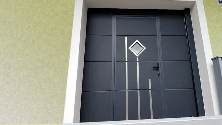 Sectional garage door with wicket & decor